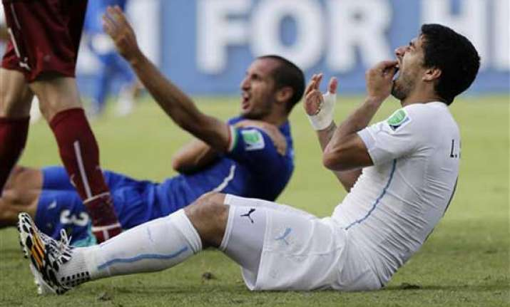 fifa world cup suarez told fifa panel bite was not
