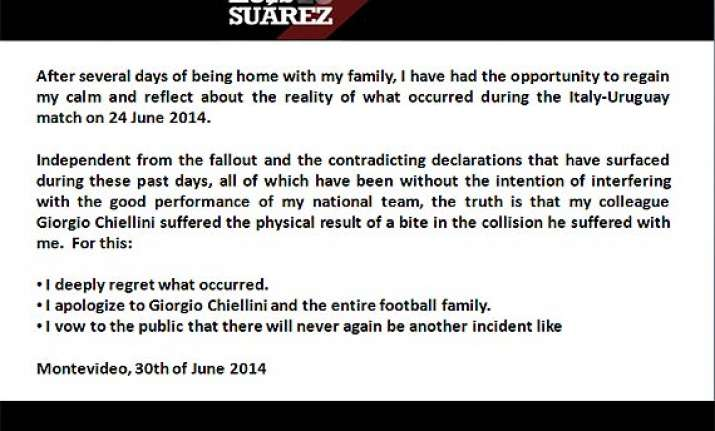 fifa world cup luis suarez apologizes for biting giorgio