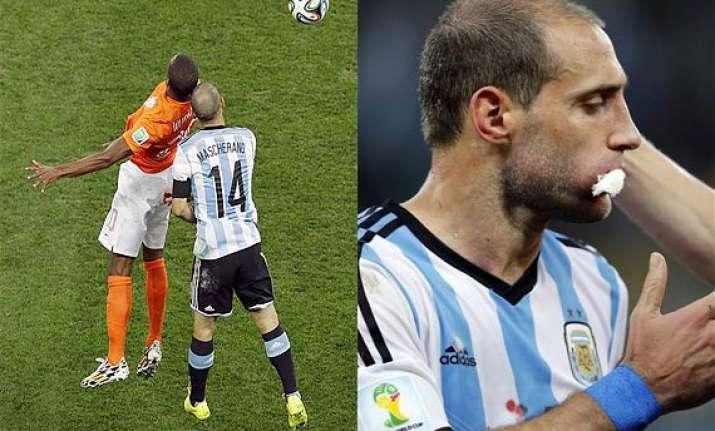 fifa world cup mascherano zabaleta play on after blows to
