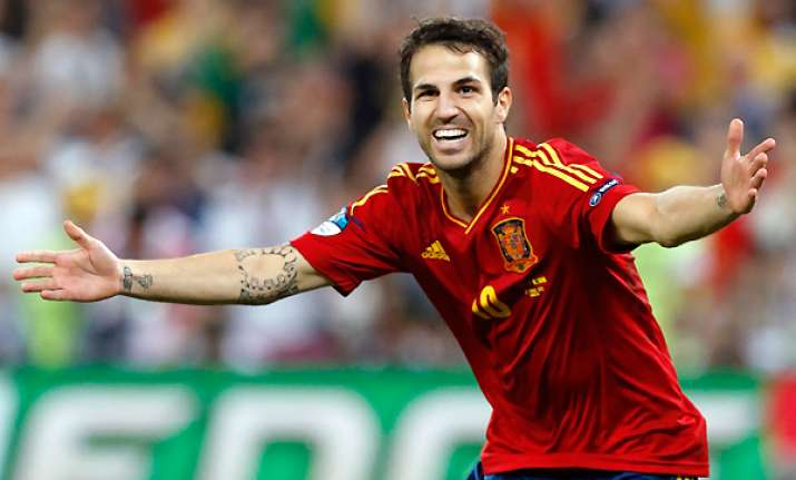 fabregas delivers again with penalty for spain