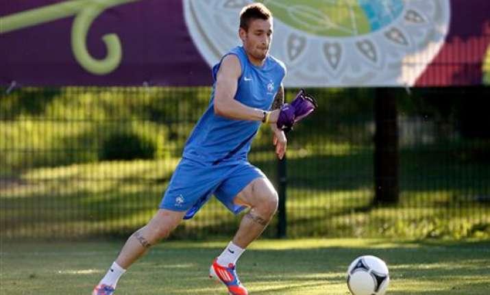 fabregas starts for spain france gets defensive