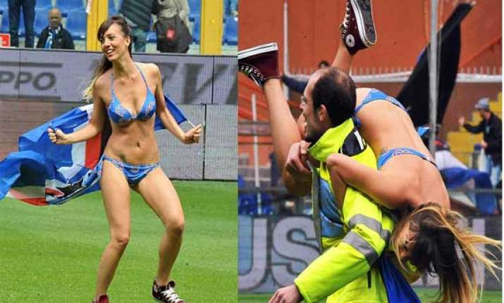 female streaker invades the pitch