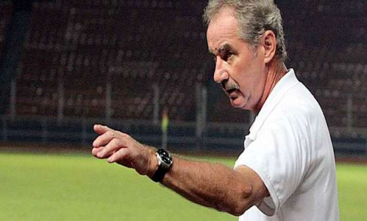 fired coach threatens action against. indonesian fa