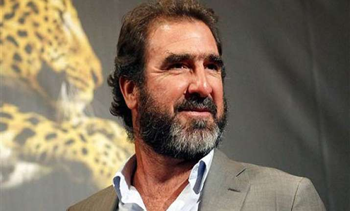 former manchester united player eric cantona arrested for