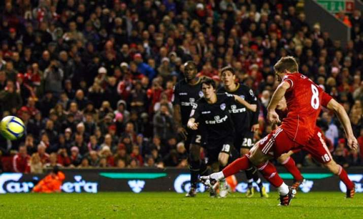 gerrard scores as liverpool beats oldham in fa cup