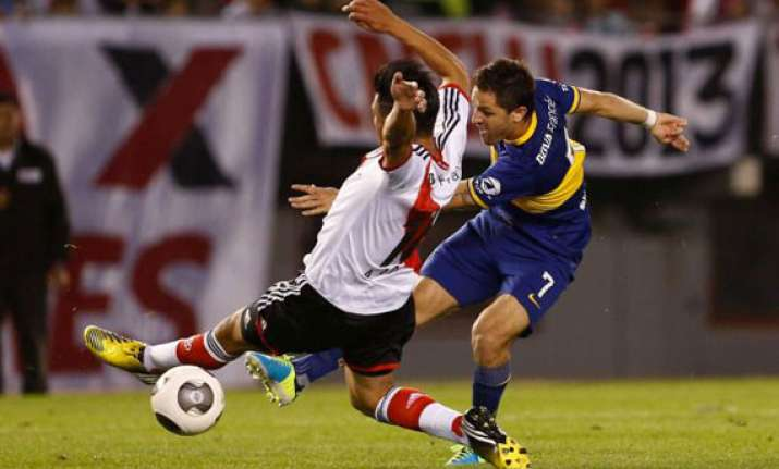 gigliotti goal gives boca 1 0 win over river plate