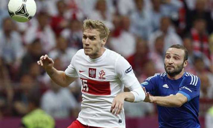 greece earns 1 1 draw against poland at euro 2012