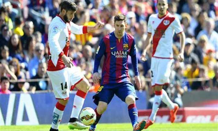 messi s record setting treble gives barca lead in spain