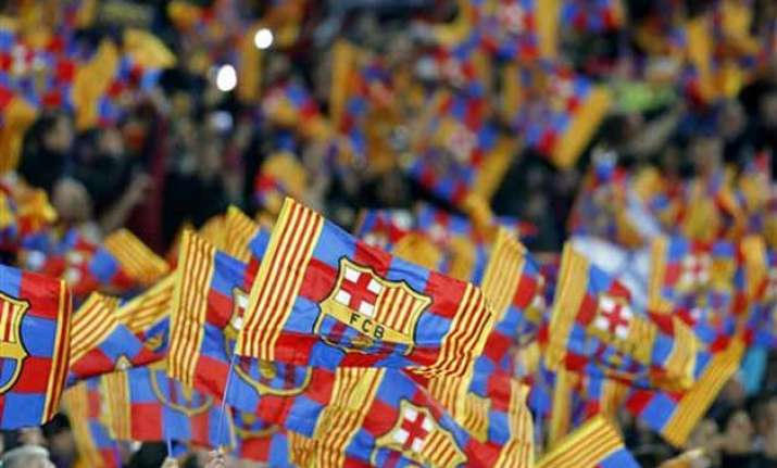 uefa charges barcelona over fan banner at man city match