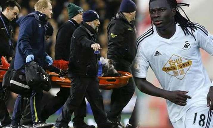 swansea striker gomis collapses during premier league match