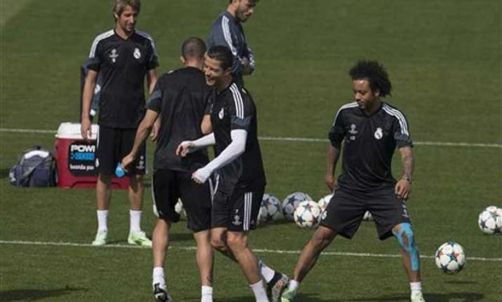 injury hit madrid hosts atletico in champions league