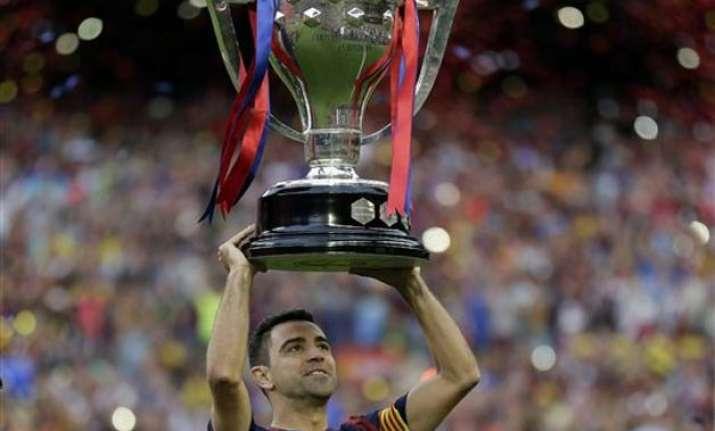xavi to leave barcelona after 17 trophy filled seasons