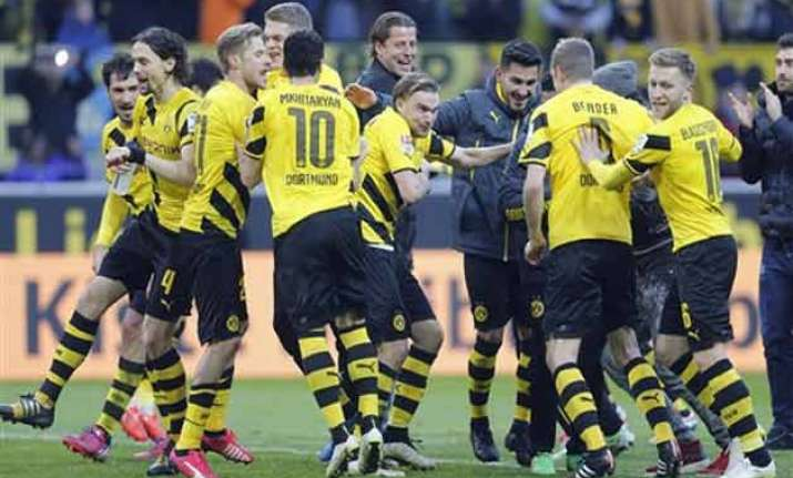 dortmund overpowers schalke 3 0 in german bundesliga