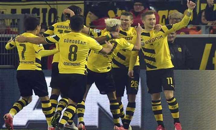 dortmund beats stuttgart 3 2 to climb to 10th in bundesliga