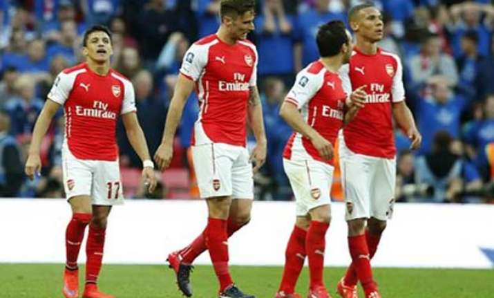arsenal looks to delay chelsea s title coronation