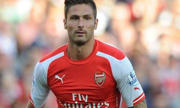 arsenal will not copy chelsea s style striker giroud