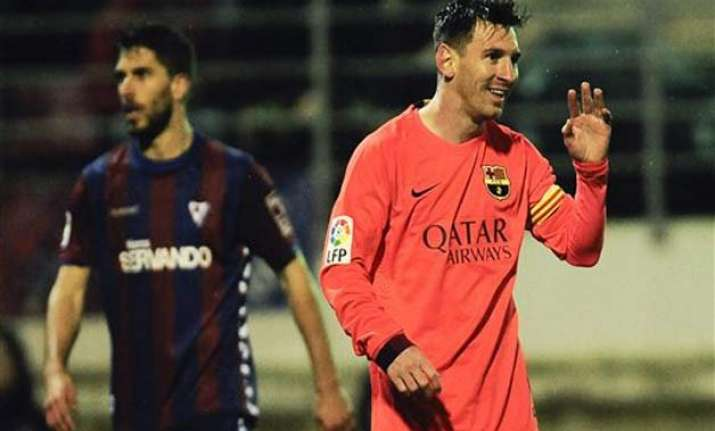 messi nets 31st 32nd league goals as barca protects lead