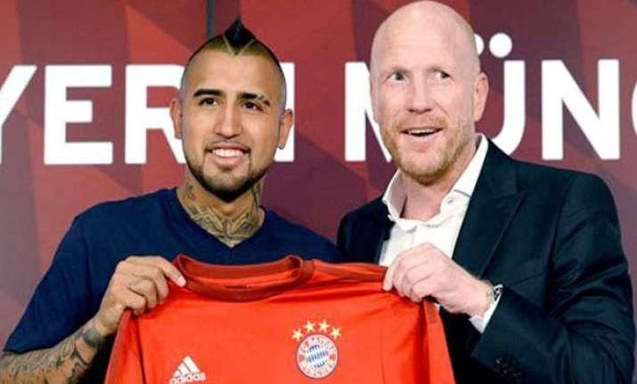 bayern munich signs chile midfielder arturo vidal