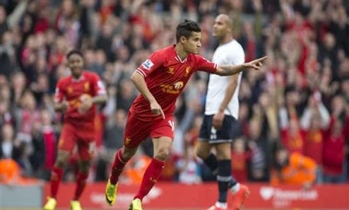 liverpool beats spurs 4 0 tops premier league