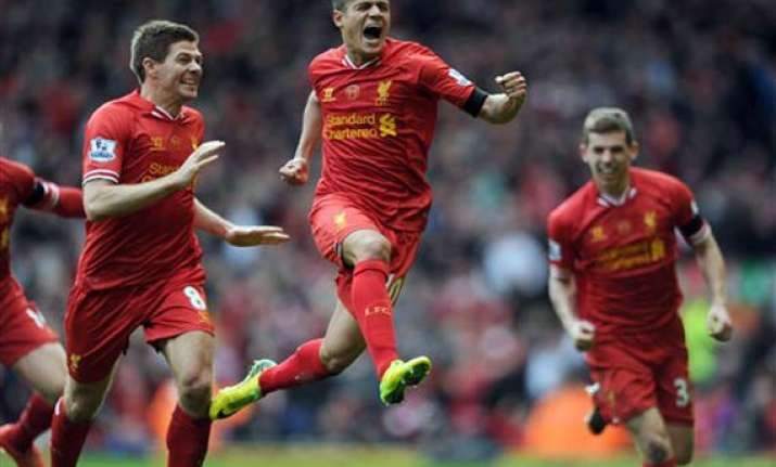 liverpool beats city 3 2 on course for epl title