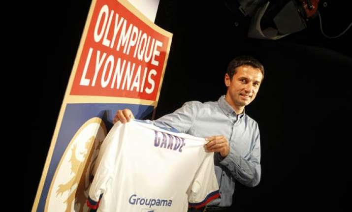 lyon names garde as new coach