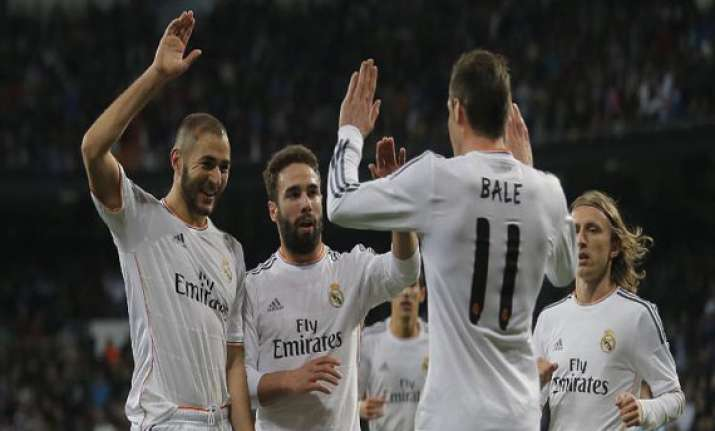 madrid s win atletico s loss leaves tie at top