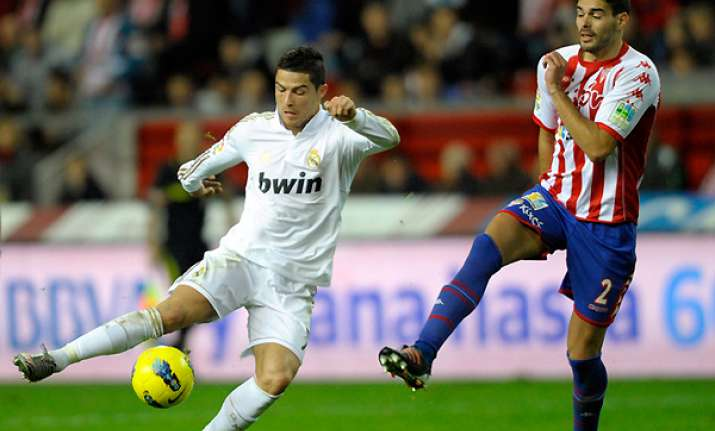 madrid beats sporting gijon 3 0 in spanish league