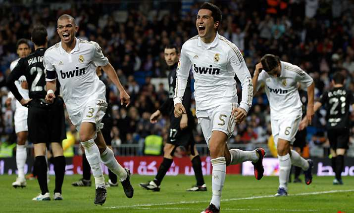madrid eases into cup last 16 with easy win