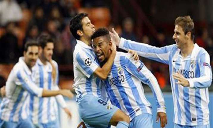 malaga rallies for 2 1 win at betis in spain