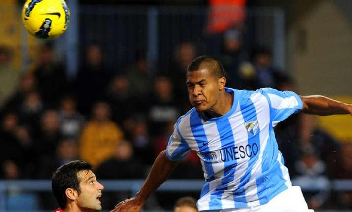 malaga draws 1 1 with osasuna in spain