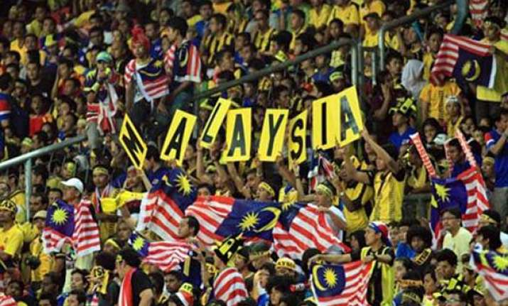malaysian football coach charged with match fixing