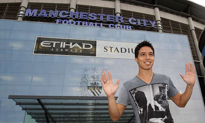 man city completes signing of nasri from arsenal