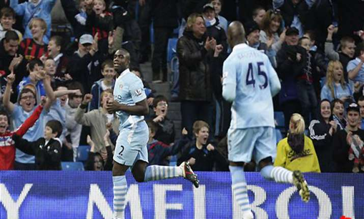 man city maintains title charge with newcastle win
