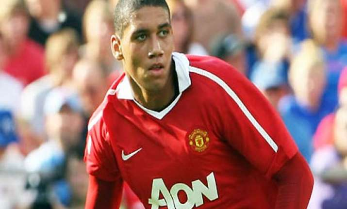 man united gives smalling 5 year contract