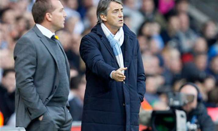 mancini needs strikers to fire at arsenal