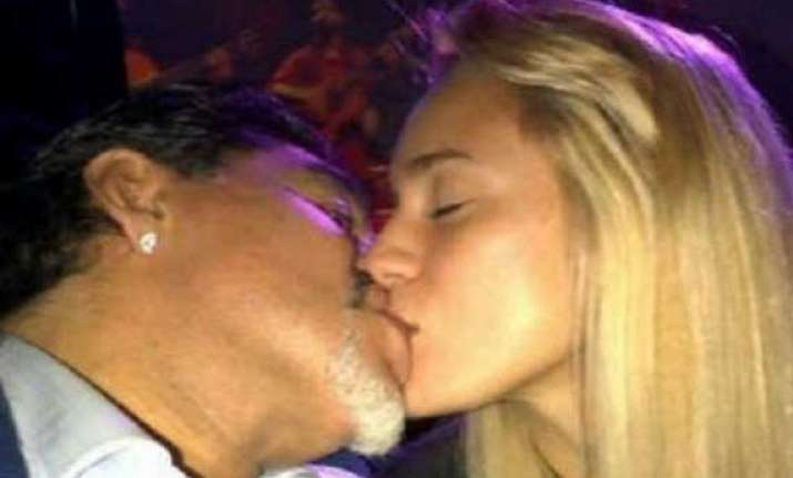 maradona fumes as his young fianc e flirts with united s de