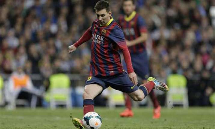 messi hat trick gives barca win at madrid