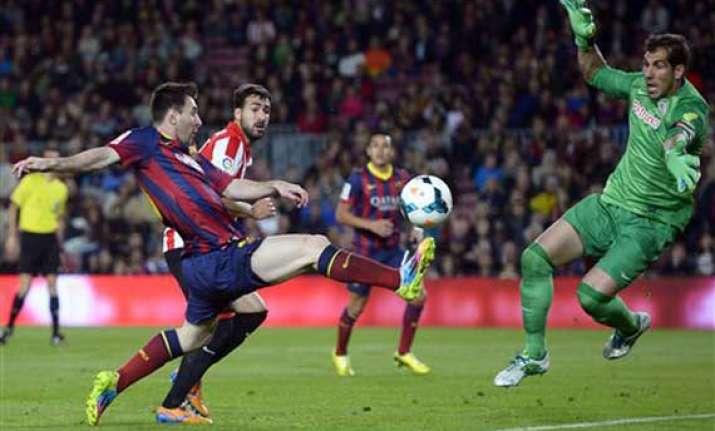 messi helps barcelona end skid beat bilbao 2 1