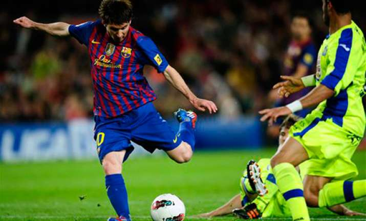 messi s 61st goal leads barcelona past getafe 4 0