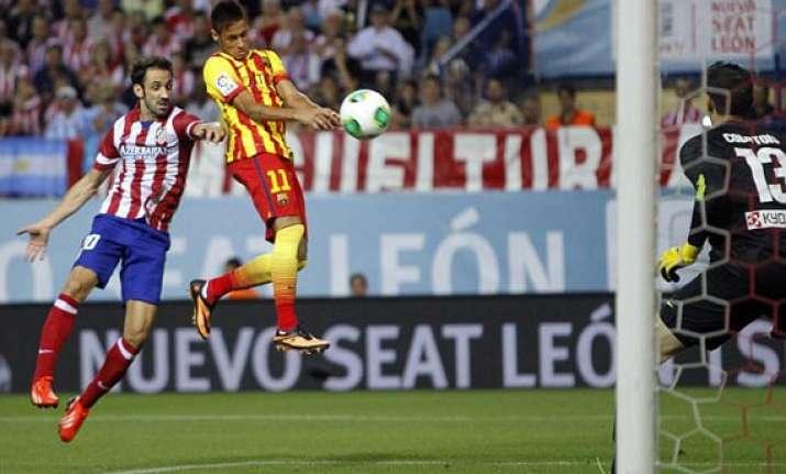 neymar helps barcelona to 1 1 draw at atletico