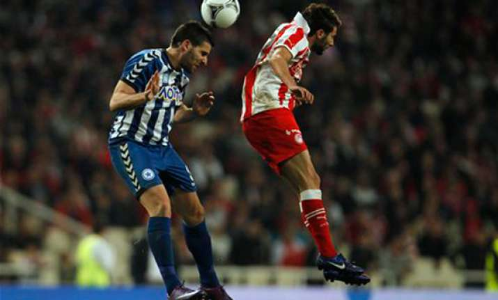 olympiakos wins greek cup final in extra time