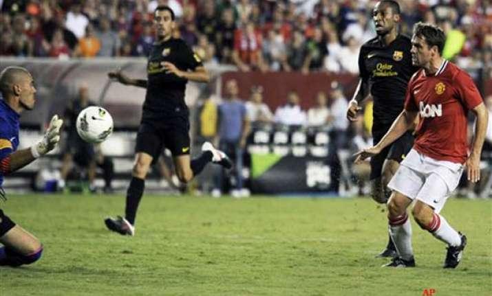 owen gives man utd 2 1 win over barcelona