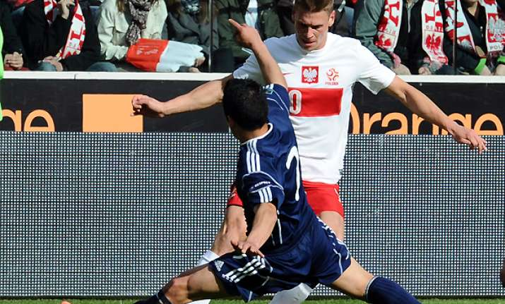 poland defeats andorra 4 0 in football friendly
