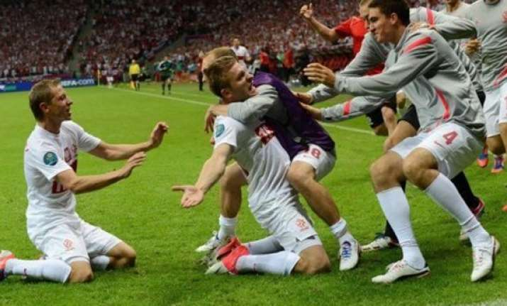 poland hold russia to stay in euro hunt