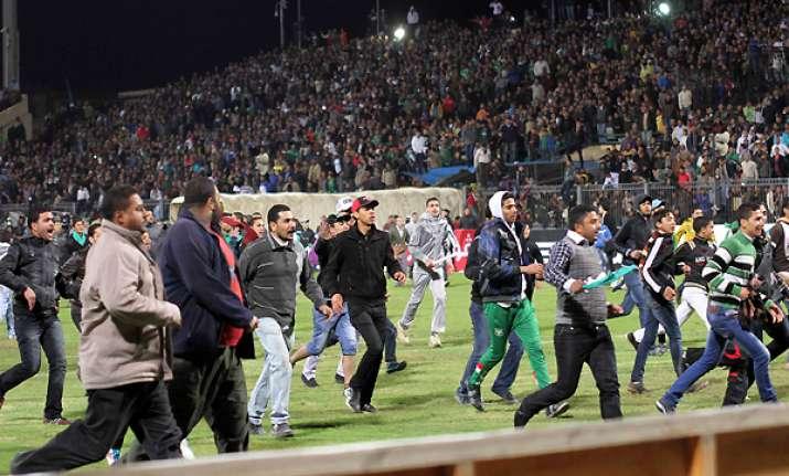 portuguese coach barely escapes egypt violence