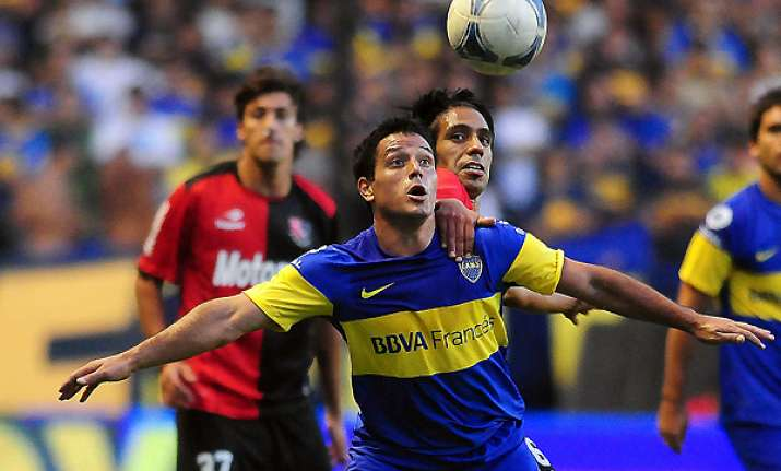 riquelme seals boca win over newell s