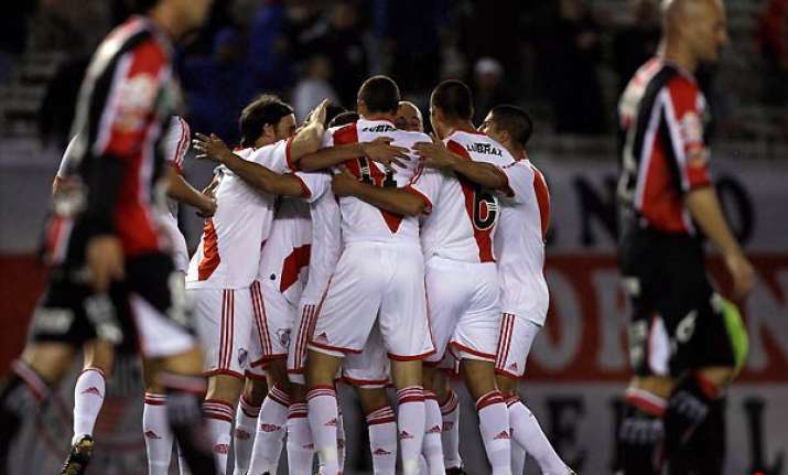 river wins opening game in second division