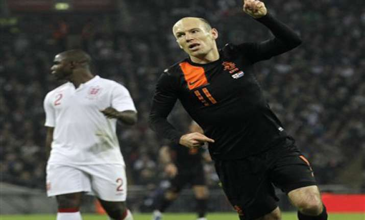 robben s double gives dutch 3 2 win over england