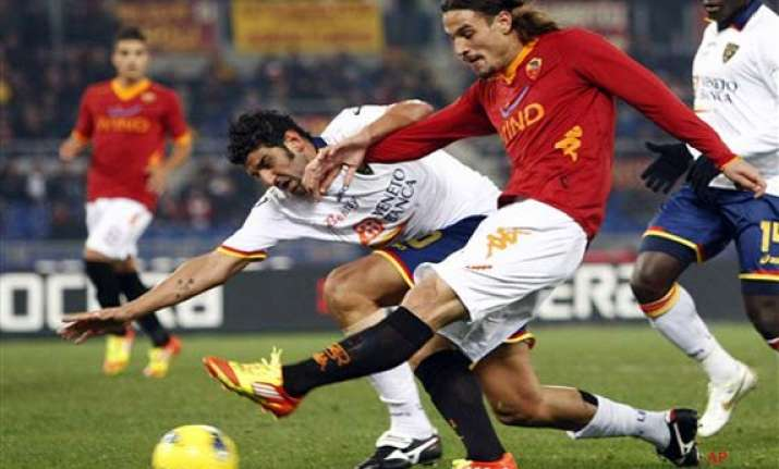 roma striker osvaldo fined banned for hitting lamela