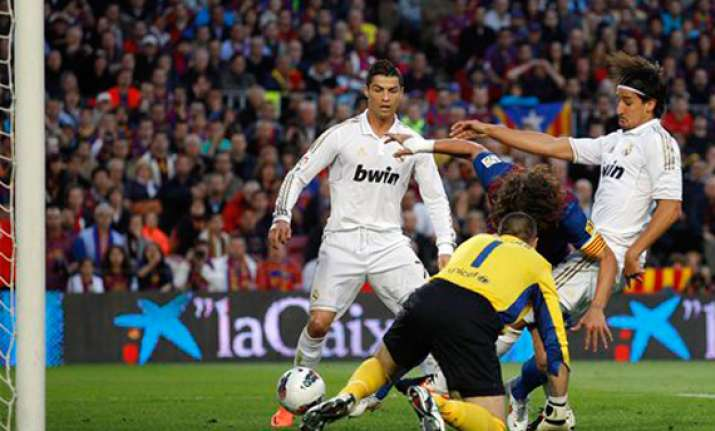 ronaldo strike helps real madrid stun barcelona